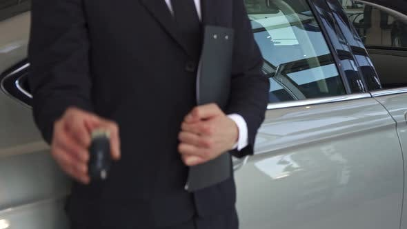 Thumbnail for Sales Manager Shows Key Near the Car