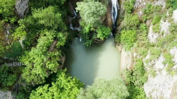 Thumbnail for Top Down View of Waterfall in the Mountains