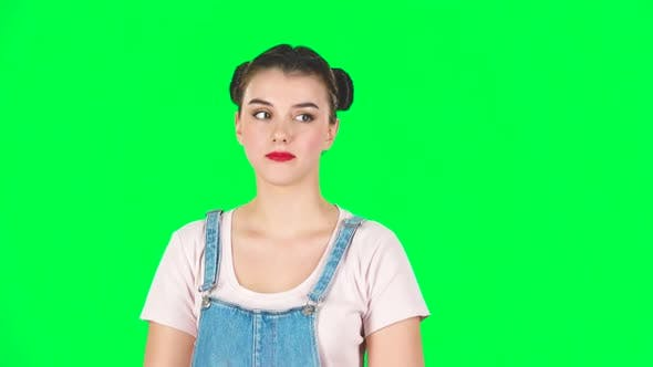 Thumbnail for Playful Girl Funny Coquetting and Blowing a Kiss on Green Screen, Slow Motion