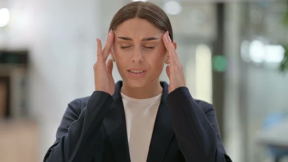 Portrait of Exhausted Businesswoman Having Headache