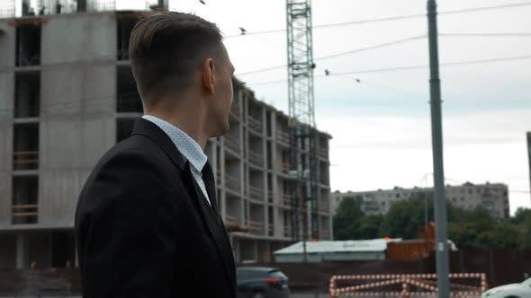Thumbnail for Businessman Walking Near Construction