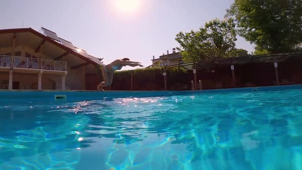 Thumbnail for Underwater Shooting. Girl Dive in Blue Swimming Pool.