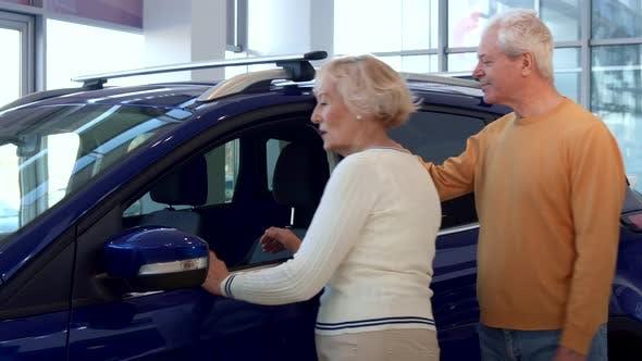 Thumbnail for Senior Couple Chooses Car at the Dealership