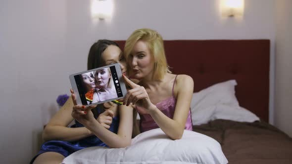 Thumbnail for Young Women Being Silly Making Selfies on Tablet