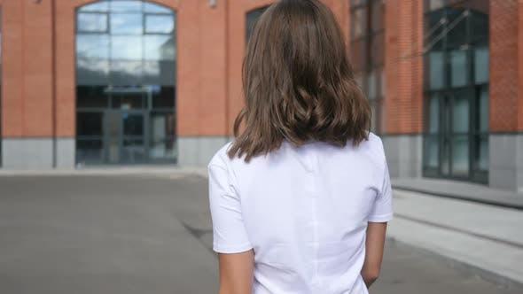 Thumbnail for Walking Outdoor  Female Designer, Back View, Loft