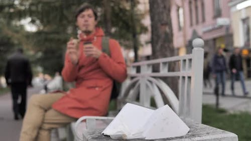 Guy Throws and Scores Crumpled Bag Into Bin with Paper