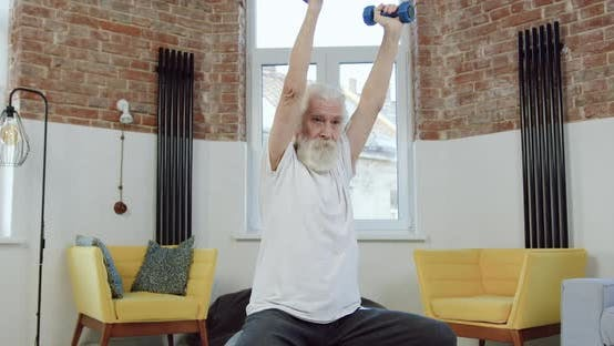 Thumbnail for Active Senior Bearded Man in Sports Uniform which Sitting on Fitball and Doing Exercises