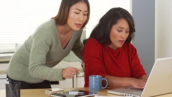 Thumbnail for Multi-ethnic businesswomen working together to meet deadline
