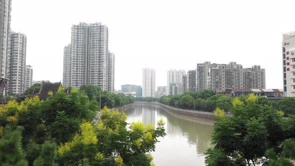 Thumbnail for Flying Above River In China City