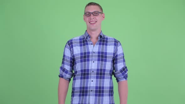 Thumbnail for Happy Young Hipster Man with Eyeglasses Smiling