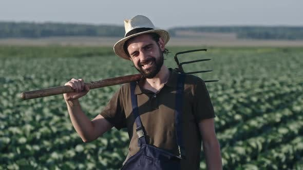 Thumbnail for Farmer Posing with Pitchfork