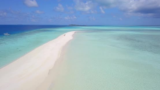 Thumbnail for Daytime fly over clean view of a white sandy paradise beach and turquoise sea background in 4K