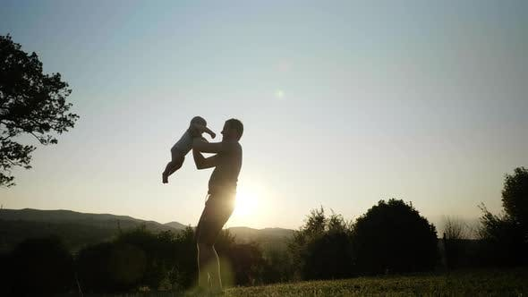 Thumbnail for View of an Energetic Father Spinning His Little Boy and Rocking Him Up and Down