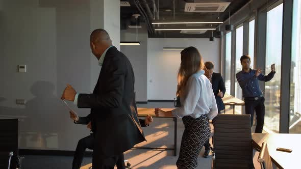 Thumbnail for Businesspeople Dancing Cheerfully in Office in Front of the Camera