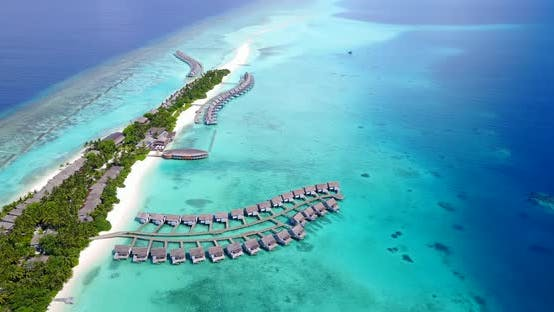 Beautiful birds eye copy space shot of a summer white paradise sand beach and aqua blue ocean backgr