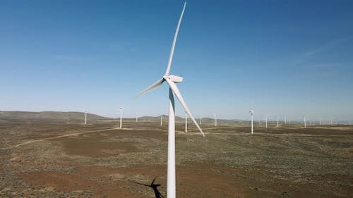 Progressive Clean Energy Wind Turbine Aerial View With Propellers Spinning Fast