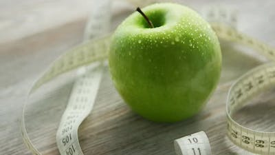 Green Apple and Tape Measure