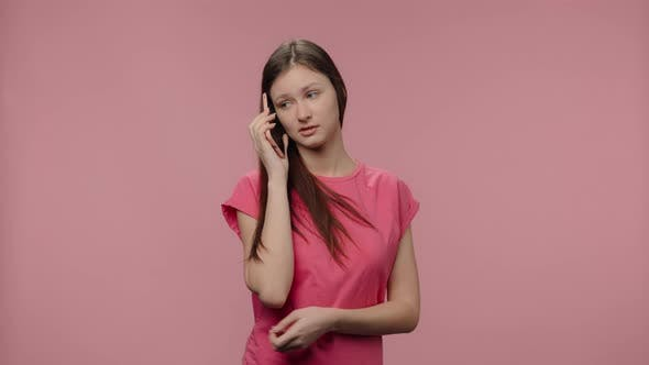 Portrait of Fashion Model Talking on Her Smartphone