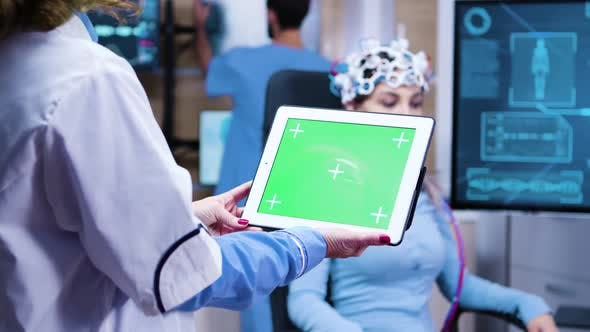 Thumbnail for Female Doctor Holding Tablet with Green Screen in a Modern Neurology Lab Science