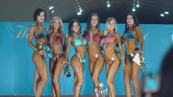 Thumbnail for Beautiful Girls Who Are Engaged in Fitness, During the Beauty Contest. They Stand on Stage in