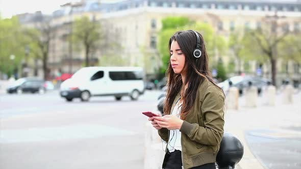 Thumbnail for Woman on street with headphones