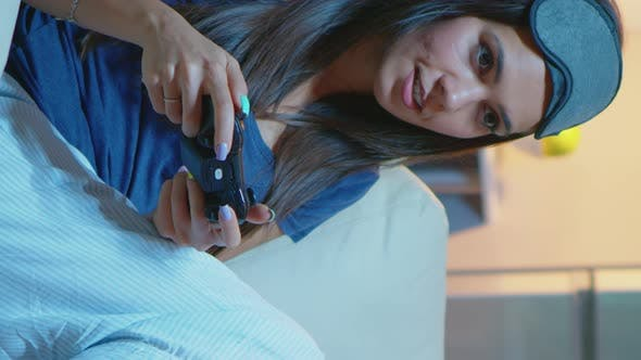 Vertical Video: Gamer Using Joystick Playing Video Games