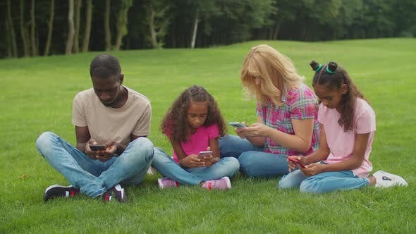 Thumbnail for Phone Addicted Family Ignoring Each Other Outdoors