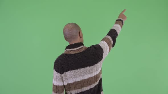 Cover Image for Rear View of Bald Multi Ethnic Man Pointing Finger Ready for Winter