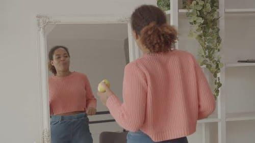 Joyful Female Admiring Her Look After Dieting
