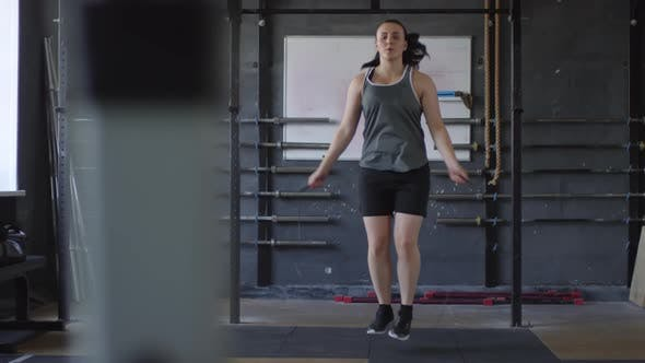 Thumbnail for Female Boxer Having Jump Rope Workout in Gym