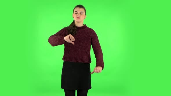 Thumbnail for Unhappy Girl Showing Thumbs Down Gesture. Green Screen