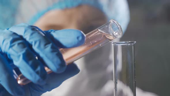 Thumbnail for Woman Scientist Working with Liquid in Science Lab. Close Up of Female Scientist Doing Laboratory