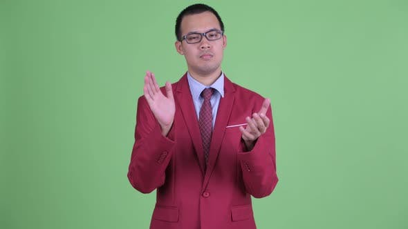Thumbnail for Asian Businessman with Eyeglasses Clapping Hands