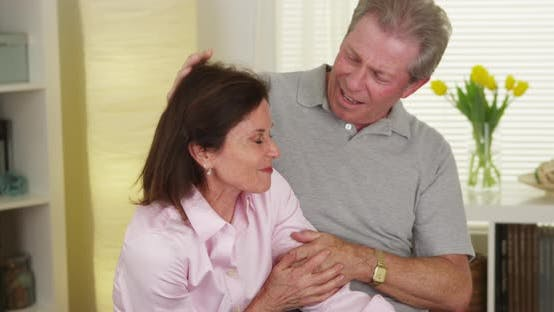 Thumbnail for Happy mature couple laughing and talking at home