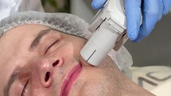 Thumbnail for Man Getting Ultrasound Skin Treatment at Beauty Clinic