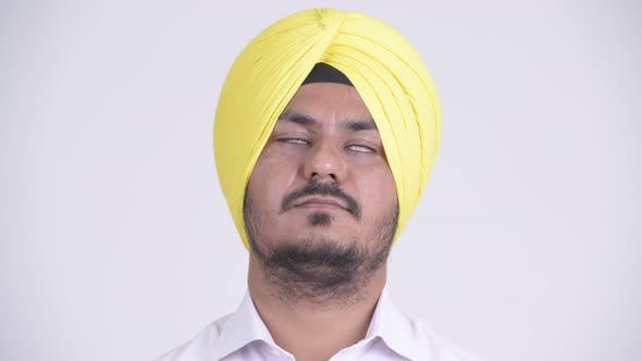 Thumbnail for Face of Happy Bearded Indian Sikh Businessman Relaxing with Eyes Closed
