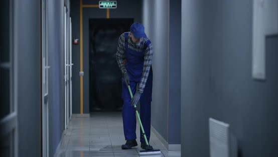 Janitor Cleaning a Corridor When Fire Breaks Out