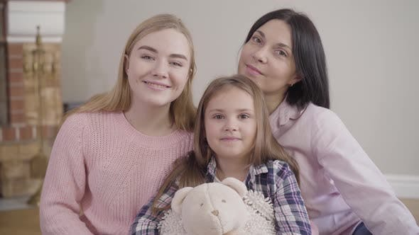 Thumbnail for Portrait of Adult Caucasian Woman, Teenage Girl and Little Cute Child Looking at Camera and Smiling