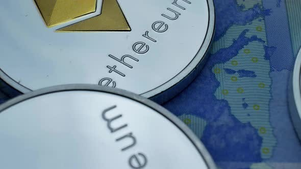 Thumbnail for Ethereum ETH Coins Rotating on Bills of Euro