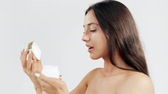 Thumbnail for Woman Smelling Cream in Jar