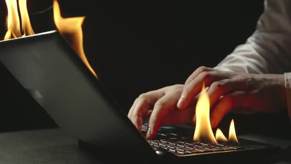 Businessman Is Typing On Burning Laptop - Slow Motion