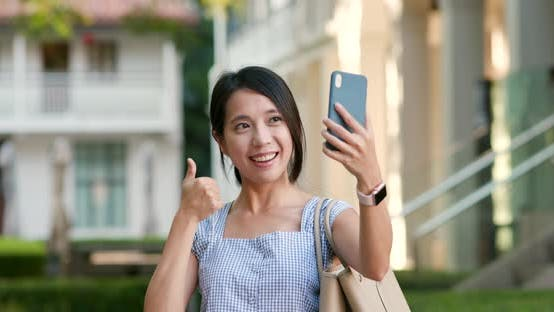 Thumbnail for Woman Take Selfie on Cellphone at Outdoor