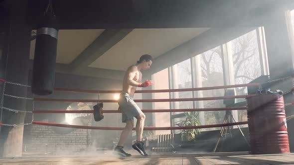 Male Boxer Dancing on the Boxer Ring