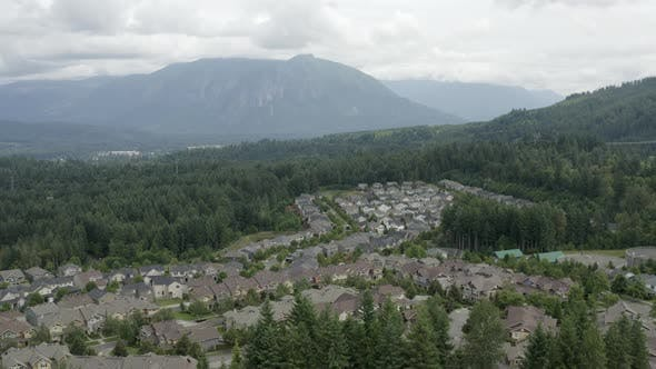 Thumbnail for Flying Away From Snoqualmie Ridge With View Of Mount Si - Forested Suburban Housing Development