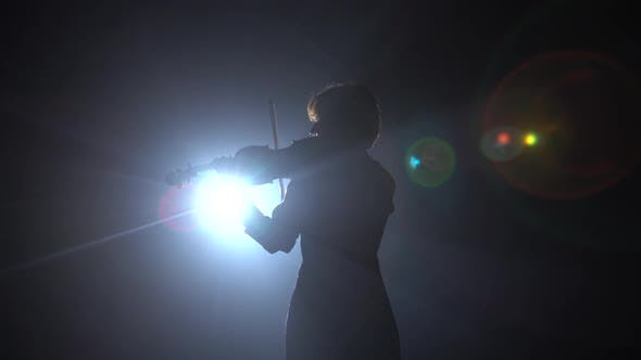 Thumbnail for Girls Standing Back and Playing on Violins in a Dark Room. Black Smoke Background. Back View