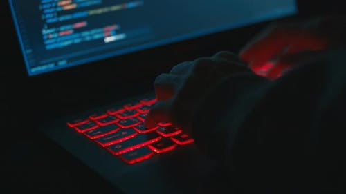 Programmer Coding At Night