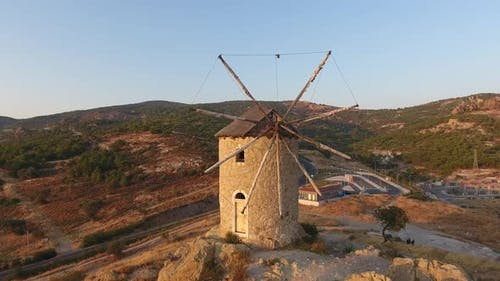 Old Traditional Historic Stone Windmill at the Sunset