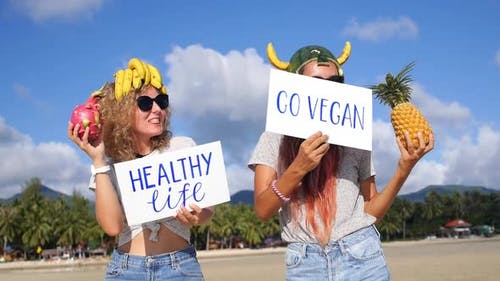 Girls Dancing on Beach With Tropical Fruits And Healthy Lifestyle Slogan