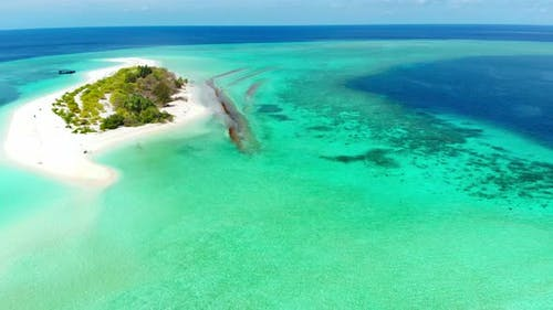 Aerial: Flying over idyllic atoll, exotic travel destination in Wakatobi National Park, Indonesia