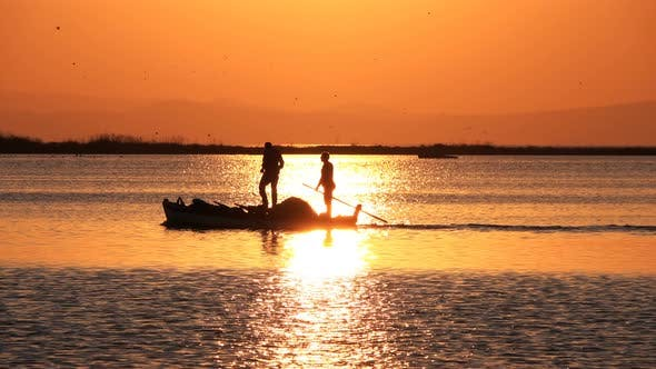Thumbnail for Sunset And Fishing Boat In Calm Sea